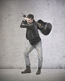 Angry handsome guitar playing stock photo