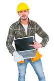 Angry handyman pointing at laptop Stock Photos