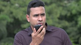 Angry Hispanic Man Using Cell Phone. A handsome adult hispanic man stock footage