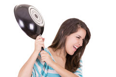Angry hispanic woman with saucepan in one hand Royalty Free Stock Photo