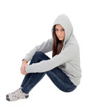 Angry hooded girl with grey sweatshirt sitting on the floor Stock Photography