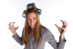 Angry Housewife. With Rolls In Her Hair on White Isolated Background Royalty Free Stock Image