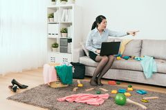 Angry housewife ask her kid to clean up stock foto's