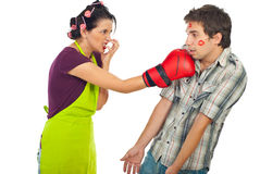 Angry housewife boxing her drunk unfaithful man Stock Image