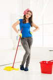Angry Housewife With A Mop Royalty Free Stock Image
