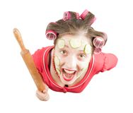 Angry housewife over white Royalty Free Stock Image