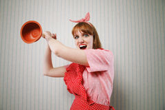 Angry housewife with plunger Stock Image