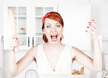 Angry housewife with rolling pin Stock Images