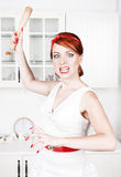 Angry housewife with rolling pin Royalty Free Stock Images
