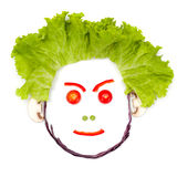 Angry human head made of vegetables Stock Photography