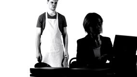 Angry husband with pan looking at working business wife, house chores tiredness. Stock photo stock photo