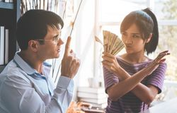 Husband and wife argue over money. Angry husband and wife argue over money stock image