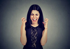 Angry hysterical young woman screaming. In frustration Royalty Free Stock Photo