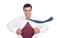 Angry Indian man tear shirt on chest. Royalty Free Stock Photo