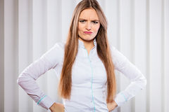 Angry and irritated business woman in office. Royalty Free Stock Photography