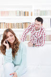 Angry jealous man spying suspecting on infidelity of his girfrie Stock Photos