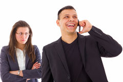 Angry jealous woman with arms crossed suspecting on infidelity stock photography
