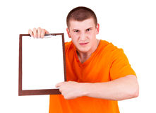 Angry joung man with tablet Royalty Free Stock Images