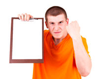 Angry joung man with tablet Royalty Free Stock Photos