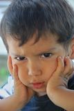 Angry kid. A little cute male child with anger on his face Stock Photos
