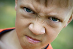 Angry kid Stock Images