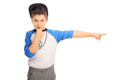 Angry kid blowing a whistle and pointing Stock Images