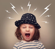 Angry kid in hat screaming white lightnings above Stock Photography