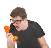 Angry and kid screams into the telephone Royalty Free Stock Photography