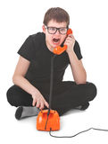 Angry kid screams into the telephone Royalty Free Stock Images