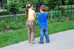 Angry kids. Girl and  boy turned the back while angry with their mother. City park in Vienna, Austria Stock Image