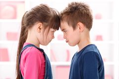 Angry kids looking at each other Royalty Free Stock Photography