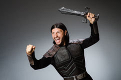 Angry knight with sword against Royalty Free Stock Image
