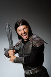 Angry knight with sword against Royalty Free Stock Photo