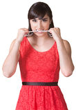Angry Lady Biting Necklace. Angry young woman biting her pearl necklace royalty free stock photo