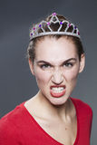 Angry lady with fancy dress costume tiara on her head Stock Photo