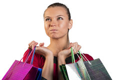Angry lady handing bags narrowing her eyes Royalty Free Stock Images