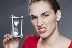 Angry lady with timer and eye brows raised Royalty Free Stock Image