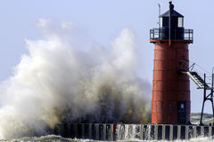 An Angry Lake Michigan and lighthouse stock photography