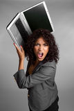 Angry Laptop Woman. Angry business woman holding laptop Stock Photo