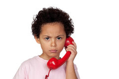 Angry latin child with red phone Stock Photo