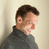 Angry laughing young Caucasian man portrait Royalty Free Stock Photography