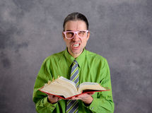 Angry lawyer with statute book and pink glasses. Angry lawyer in green shirt and necktie with statute book and pink glasses Royalty Free Stock Photos