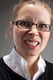 Angry leadership businesswoman. Portrait of angry leadership businesswoman in glasses Royalty Free Stock Images