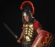 Angry legionary soldier. With a gladius and shields Royalty Free Stock Photo