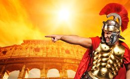 Angry legionary soldier. In front of coliseum Royalty Free Stock Images