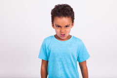 Angry little African American boy Stock Images