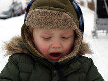 Angry little boy. In the cold,winter day royalty free stock images