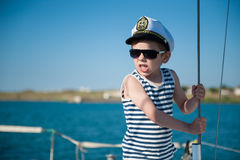 Angry little boy captain shouting orders aboard vessel Stock Image
