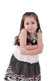 Angry little girl with arms crossed Royalty Free Stock Photos
