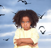 Angry little girl with beautiful hairstyle Stock Photo